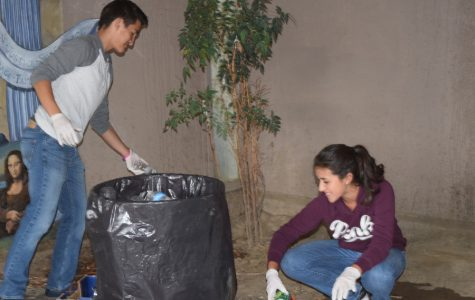 Michael Chavarria and Alyssa Catalan recycle bottles and cans for cross country.