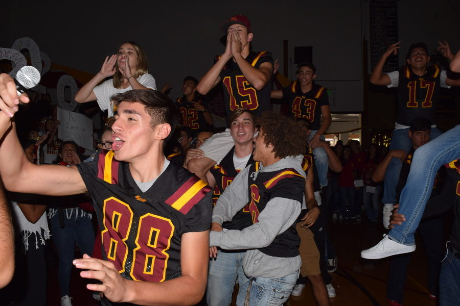 Football+players+enjoy+cheering+during+the+Homecoming+Rally.