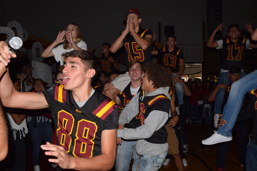 Football players enjoy cheering during the Homecoming Rally.