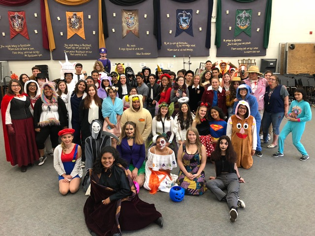 LBHS+band+posed+for+a+group+picture+after+the+Halloween+parade.