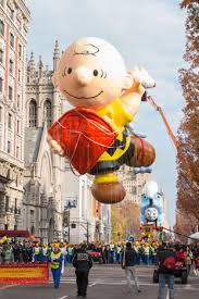 The Charlie Brown balloon soars above the New York streets at the Macy's Day parade.