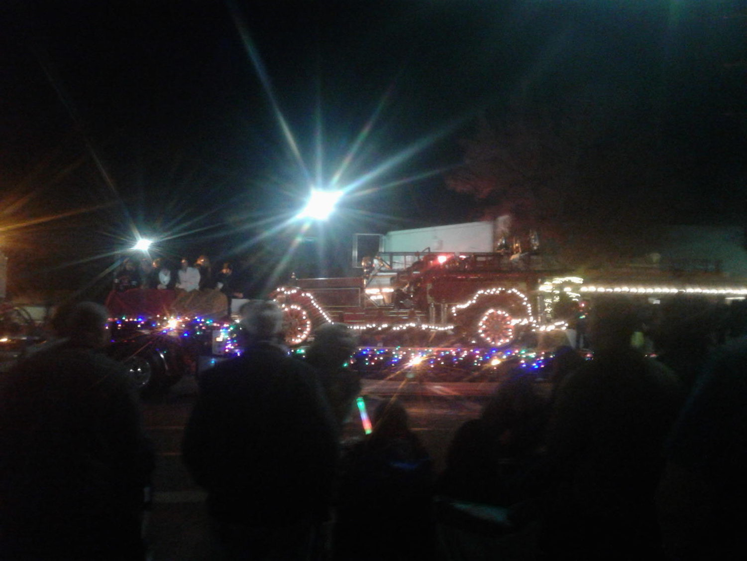 Citizens gather together to celebrate the holiday season with a parade.