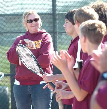 Ms. Barcellos with her tennis team.