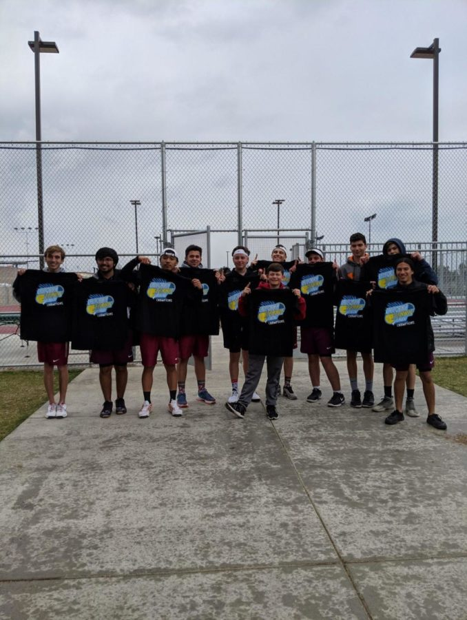 LB boys tennis team show off their champion shirts.