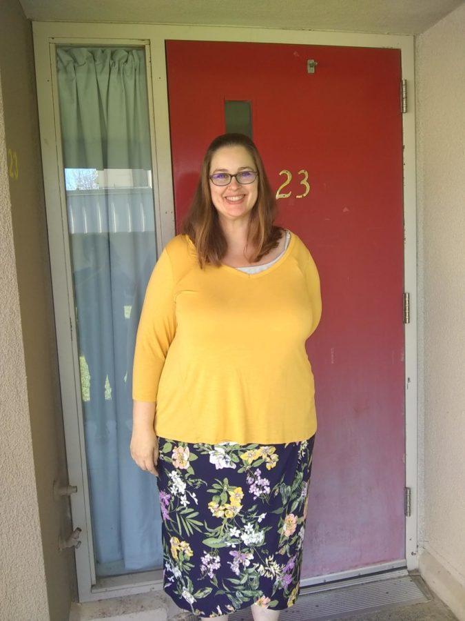 Ms.+Mankin+smiles+in+front+of+her+door+after+class.