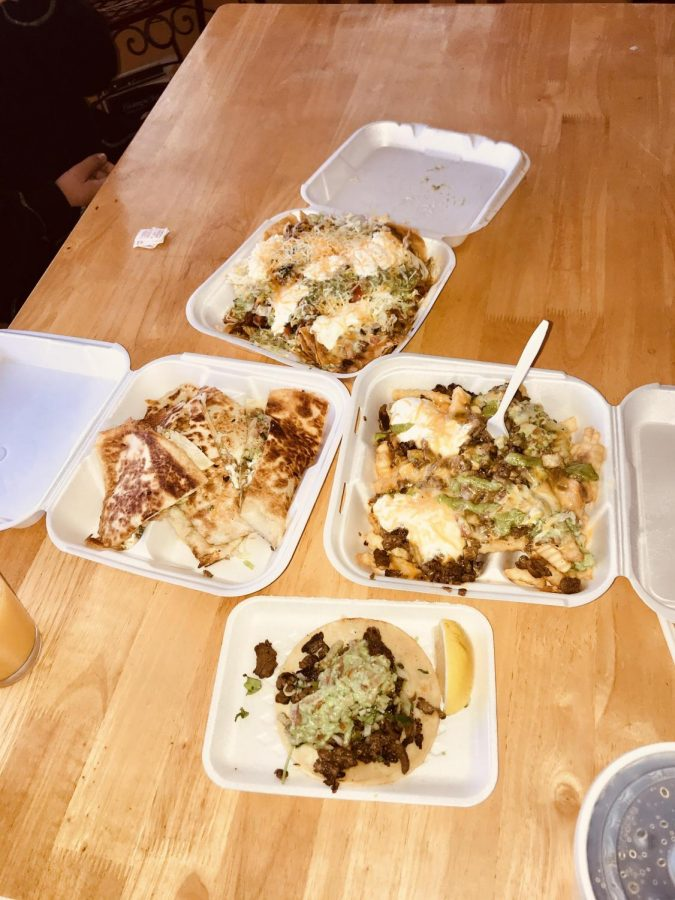 Tacos, carne asada fries, beef nachos, and a chicken quesadilla from Cotija Taco Shop.