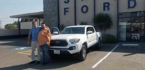 Mr. Blackwell and a client seal the deal with a Ford truck despite the Covid pandemic.