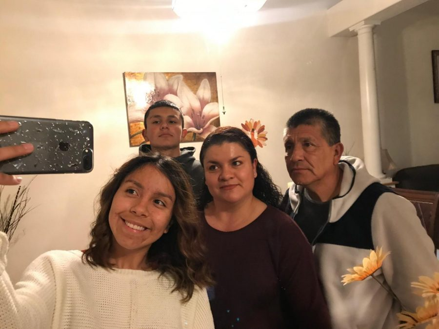 Jenny Prado (left) with her younger brother and parents.
