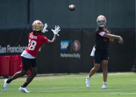 May 14, 2021; Santa Clara, California, USA; San Francisco 49ers quarterback Trey Lance (5) works on his passing during the first day of a rookie minicamp at Levi
